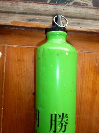 "Yangshuo Mountain Retreat: Chipped, Dented, Old, Unsanitary looking ""reusable water bottle"" for guests."