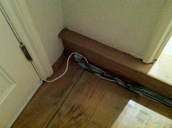 20 Hertford Street: Cables snaking around the front door