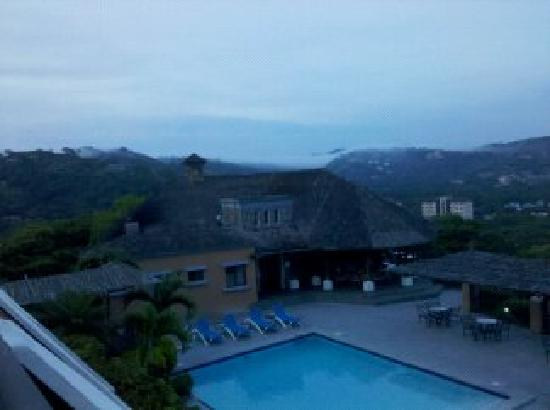Villas Sol Hotel & Beach Resort: View from Room - Hotel Section 2nd Floor (Evening Storm Rolling In)