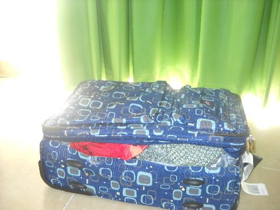 Costa Caribe Beach Hotel & Resort: this is my suitcase they cut open in our room and stole everything.