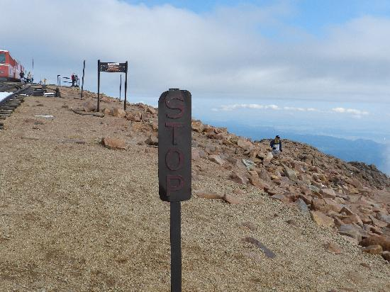 Pikes Peak sign telling you to STOP @ La Creperie