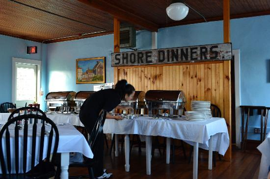 Narragansett Inn: Indoor dining room with historic shore dinner sign