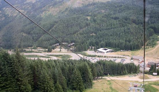 Crystal Mountain Hotels Alpine Inn: View looking down as we went up the Gondola - Crystal Mtn Hotels & the ski shops are below