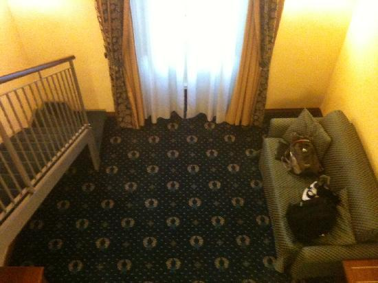 Hotel San Giorgio: View of downstairs from bed area.  Note the steep stairs on the left.