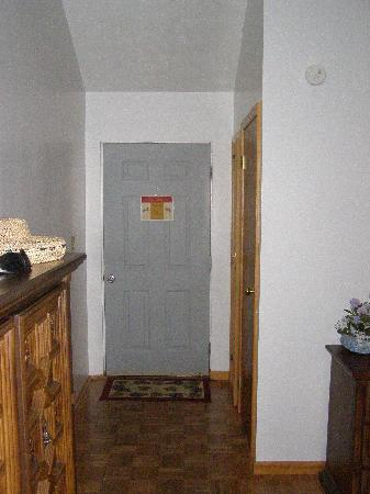 The Cherry Orchard B&B: Entrance door with closet and large bathroom to the right