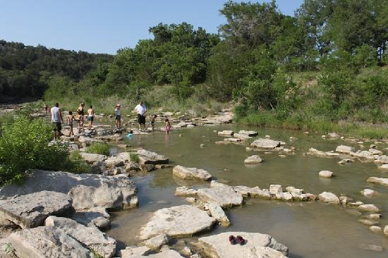 Glen Rose, TX : Visitors explore for dino tracks in the Paluxy River.
