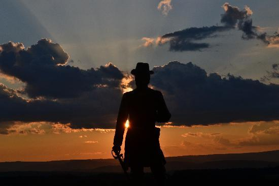 Gettysburg National Military Park: A statue at sunset on top of Little Round Top