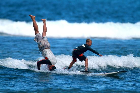 Royal Hawaiian Surf Academy: Younger brother surfing beside one of the talented instructors
