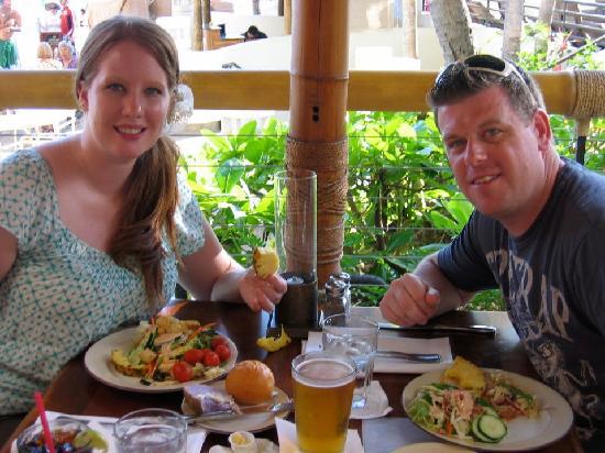Duke's Waikiki: My husband and I enjoying the delicious salad bar