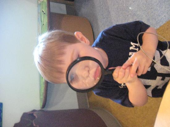 Delaware Children's Museum: He loved using the magnifying glass!