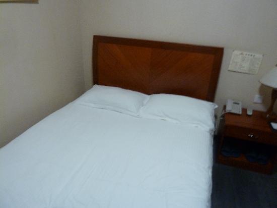 Puli Hotel Dandong: Bett