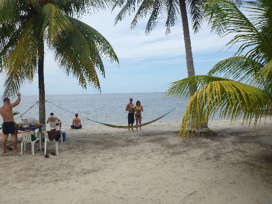 Livingston, Guatemala: Drinking coco locos on the beach at playa blanca