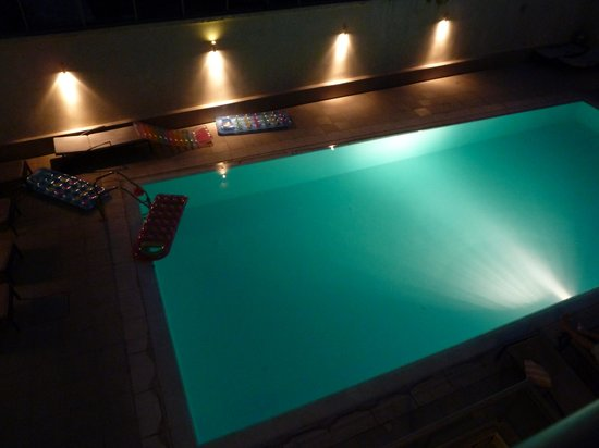 Angela Suites + Lobby: the pool at night