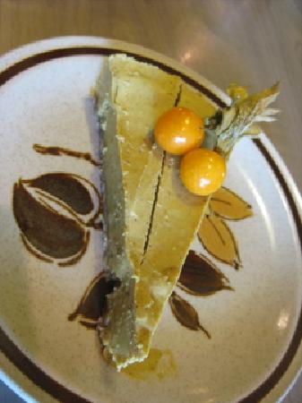 "Gratitude Cafe: raw flavour-of-the-day ""cheescake"" with tumeric, cardomom, and cinnamon spices"