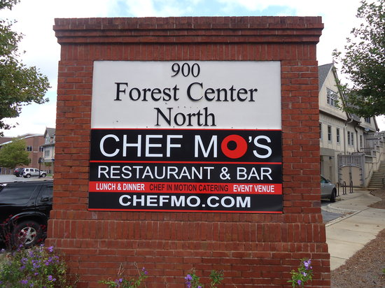 Chef MO's Restaurant and Bar: 1.3 mi. south of I-40 on Hendersonville Road  Left on Seminole St.