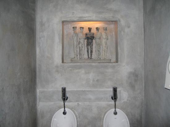 Paradise Road Tintagel Colombo: pool statue detail mirrored in mens toilet
