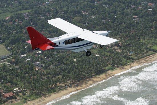 Deccan Aviation Lanka : Our Airvan flying South along the West coast near Kalutara