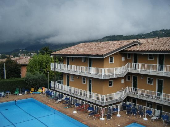 Residence Villa Rosa - Garda: view of pool and far apartment block from our balcony, A bit cloudy on this day, but the weather