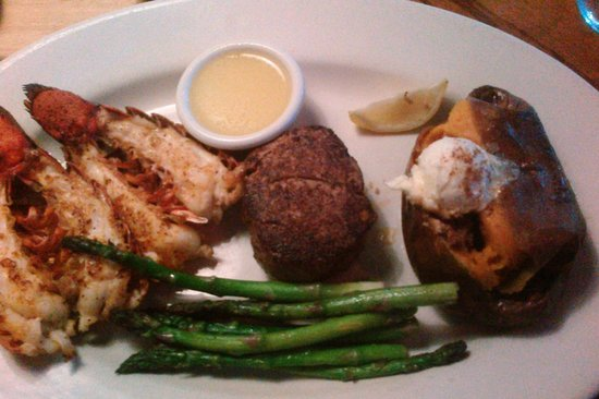 Outback Steakhouse: grilled lobster, filet, and vegetales