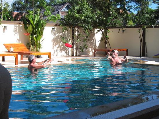 ชาญ รีสอร์ท: Naturists playing Frisbee in the pool