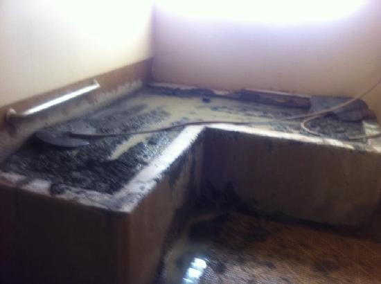 Calistoga Golden Haven Hot Springs Spa: The Volcanic Mud Bath, you sit end to end.