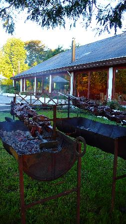 Complejo Alto Villarrica: Asado Chileno- this is REAL BBQ (you can see the restaurant in the back)