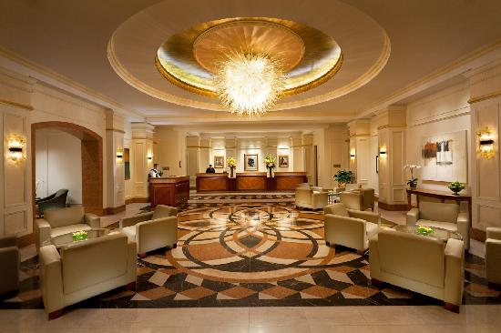 Conrad Indianapolis: Our lobby exudes warmth as it stands ready to greet guests with flawless service.
