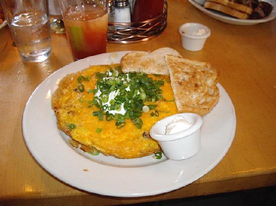 Mother's Bistro & Bar: Stuffed Frittata open-faced omelet with bacon, cheddar cheese, potatoes, sour cream, gr onions