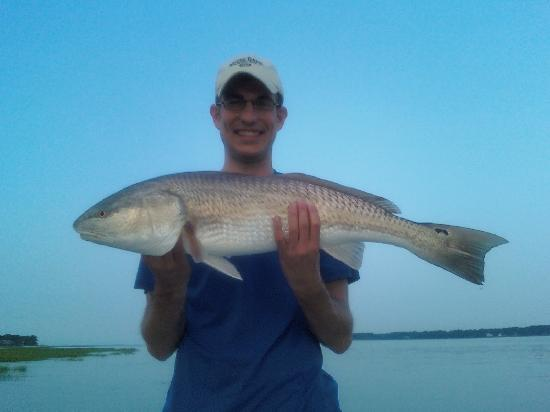 "Tailer May'D Charters, LLC: 34"" red fish at sunrise."