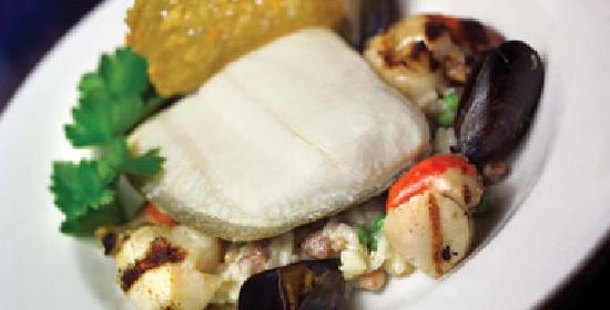 Moorings Hotel : Halibut on sweet Pea rissotto with scallops and mussels