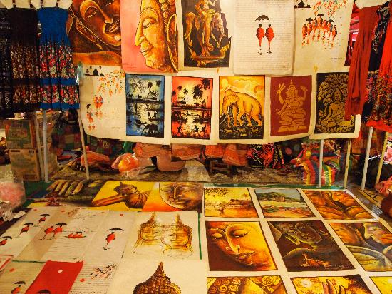 Luang Prabang Night Market: Local Laotian paintings for sale at a market stall
