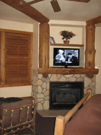 The Lodge at Breckenridge: Seating area with 4 shuttered windows overlooking Breckenridge Ski Slopes