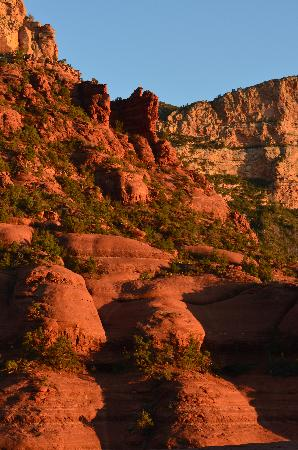 Pink Jeep Tours Sedona: Pink Jeep drives over some rocky red terrain
