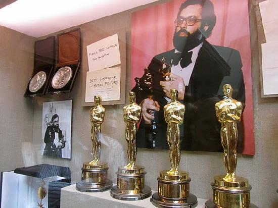 Intimate Wine Tours: Francis Ford Coppola pictured with awards at the New Coppola Winery.