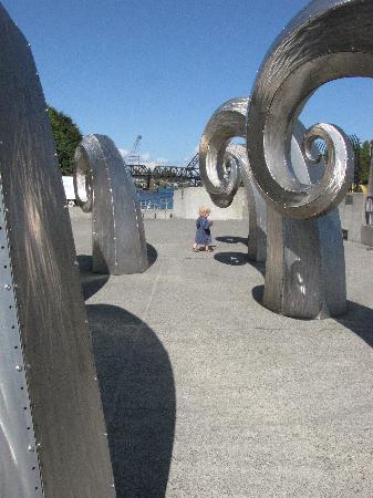 Hiram M. Chittenden Locks: Brushed steel wave sculpture.