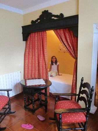 """Hotel San Gabriel: Our daughter's """"Princess Bed"""" - can also be sitting area -- in our king room."""