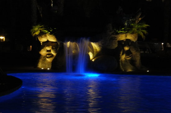 Camping & Resort Sanguli Salou : This is one of the pools in the evenening - Makes a perfect backdrop for the Restaurant