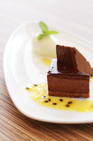 PizzaZo Bistro: Crispy Chocolate and Almond Flavored Cake- with passion fruit sauce and vanilla ice-cream
