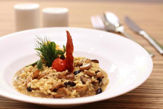 PizzaZo Bistro: . Creamy Mushroom Risotto Arborio - with tomato confit and crisp parmesan