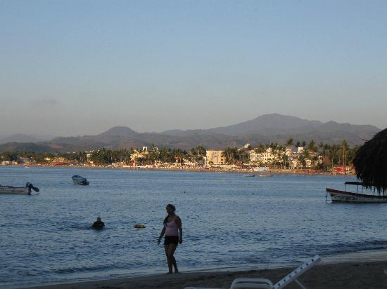 Decameron Los Cocos: Main beach at hotel and bay view at sunset.