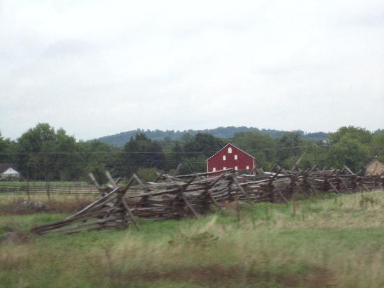 Gettysburg Battlefield Bus Tours: More battlefield. That red barn in the background was where a whole platoon was burned to death.