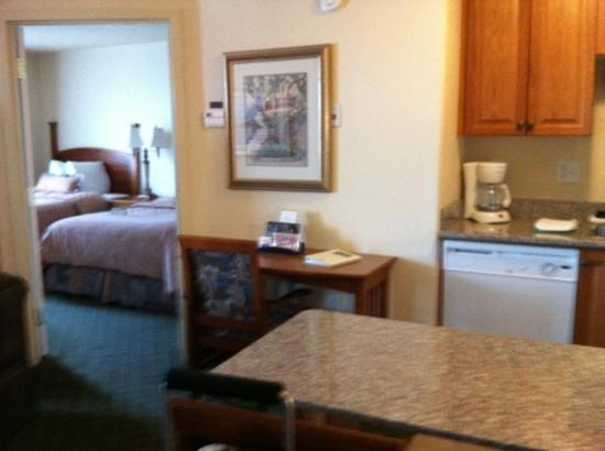 Holiday Inn Express and Suites Medicine Hat: kitchen and first bedroom with two double beds