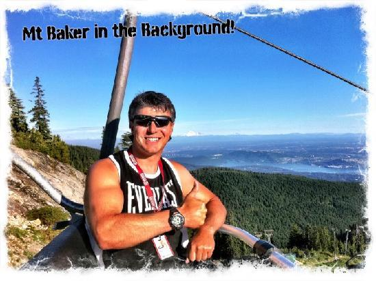 """Grouse Mountain Skyride: Jay """"The Funologist"""" on the Chairlift with Mt Baker in the background"""