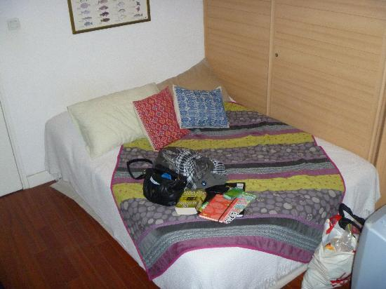 Habitation Bougainville: our bed with all our stuff on it