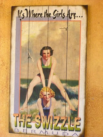 One of the cool posters on the porch at the Swizzle Inn