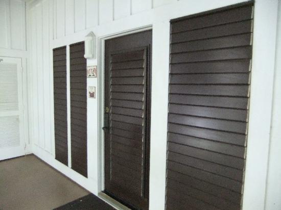 Kiahuna Plantation Resort: A view of the front entrance with the shutters for ventilation.