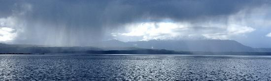 World Heritage Cruises: Snow capped mountains and rain seen from the Eagle