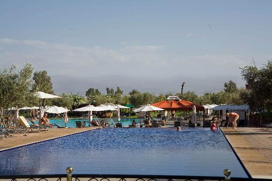 Eden Andalou Hotel Aquapark & Spa: The blue pool (atlas mountains in background)