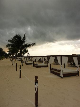 Excellence Riviera Cancun: Beach beds at sunrise, storm on it's way