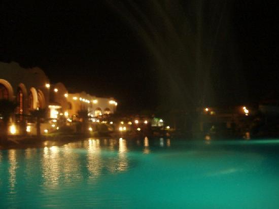 Dreams Beach Resort: Pool area at night.